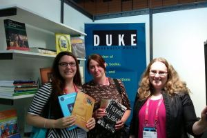 L to R: Librarians Elizabeth Chapman (University of Sheffield) and Lauren Smith (University of Strathclyde) with Library Relations & Sales Manager Kim Steinle at the Duke Univesrity Press booth at IFLA.