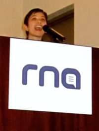 "Tikkun Managing Editor Alana Price accepts the RNA 2014 ""Magazine of the Year: Overall Excellence in Religion Coverage"" award."