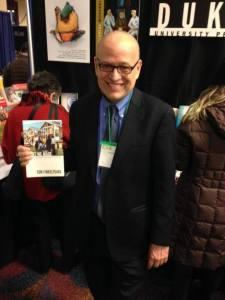 """Tom Finkelpearl, New York City's Commisioner of Cultural Affairs, with his book """"What We Made."""""""