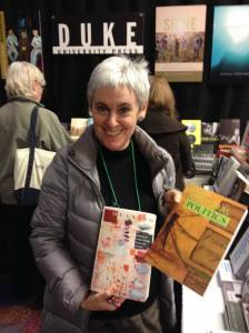 """Mira Schor with her book """"M/E/A/N/I/N/G"""" and an issue of """"Cultural Politics"""" in which she has an article."""