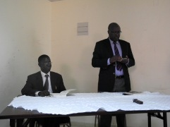 Peter Mugyenyi, Director, Joint Clinical Research Centre (speaking) and Edward Kirumira, Principal, College of Social Sciences