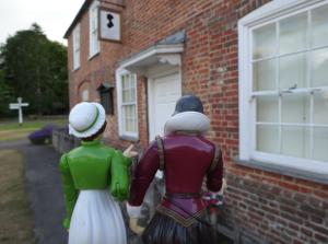 Jane showing Will Jane Austen's home at Chawton.