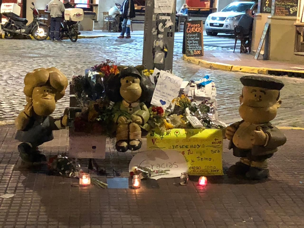 Photo of Mafalda statue surrounded by flowers and candles