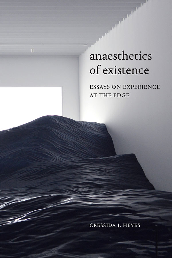"""Cover of Anaesthetics of Existence by Cressida J. Heyes. Black text over fine art installation """"mé,"""" Roppongi Crossing 2019: Connexions, featuring a white room full of stationary ocean waves."""